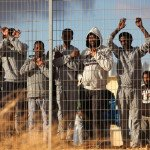 African migrants protest outside Holot detention center  near Ktsiot, in the Negev Desert, southern Israel. African migrants, most of them from Eritrea and Sudan, have in the past few weeks staged a number of protests against Israel's refusal to grant them refugee status and the opening of 'Holot'. February 17, 2014. Photo by FLASH90 *** Local Caption *** ????? ????????? ??? ???? ????? ???????